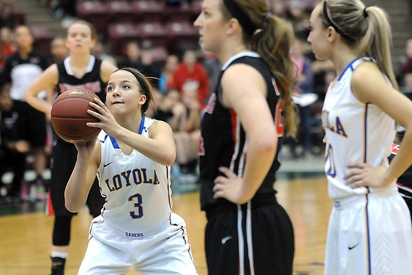 Loyola's Lindsey Theuninck concentrates on her first free throw with .4 seconds left in a tie game during overtime of the Class A quarterfinal game Thursday at Mariucci Arena. Pat Christman