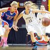 Mankato Loyola's Aunikah Bastian (11) and Win-E-Mac's Madison McKeever race for a loose ball during the first half of the Class A semifinal game Thursday at Williams Arena. Pat Christman