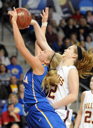 Mankato Loyola's Megan Schroeder is fouled by Lester Prairie/Holy Trinity's Emily Schnaser during the second half of the Section 2A championship game Friday at Bresnan Arena.