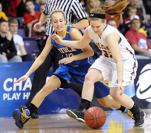 Mankato Loyola's Jordyn Strachan and Lester Prairie/Holy Trinity's Emily Schnaser chase down a loose ball during the first half of their Section 2A championship game Friday at Bresnan Arena. Pat Christman