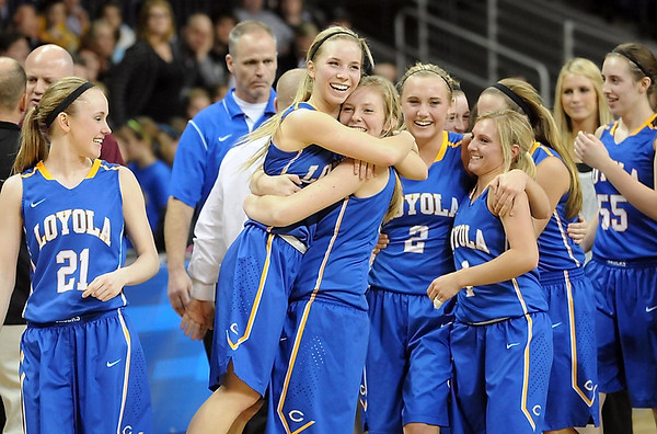 Mankato Loyola's Emily Gaspar lifts up teammate Aunikah Bastian after defeating Lester Prairie/Holy Trinity to win the Section 2A championship game Friday at Bresnan Arena. Pat Christman