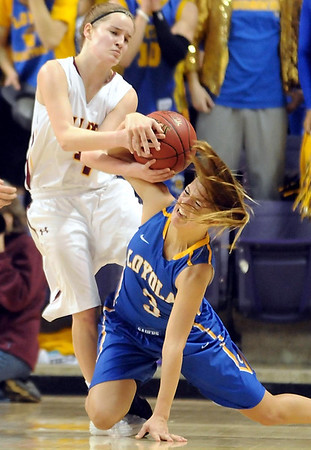 Mankato Loyola's Lindsey Theuninck (3) tries to take the ball from Lester Prairie/Holy Trinity's Steph Lohse during the first half of their Section 2A championship game Friday at Bresnan Arena. Pat Christman