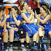 Aunikah Bastian sits in a teammate's lap as they celebrate near the end of the Section 2A championship game Friday at Bresnan Arena.