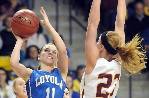Mankato Loyola's Aunikah Bastian goes up for a shot during the first half of their Section 2A championship game Friday at Bresnan Arena. Pat Christman