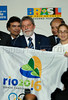 Brazilian President Luiz Inacio Lula da Silva holds a flag with a Brazilian paralympic athlete Karla Cardoso, right, during a ceremony to celebrate Olympic Day at Guabanabara palace, Rio de Janeiro, Brazil, June 23, 2008. Rio de Janeiro is a candidate city to host the 2016 Olympic Games. Chicago, Tokyo and Madrid are the other candidate cities. (Austral Foto/Renzo Gostoli)