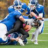 Lunenburg's Joseph Nelson tackles Murdock's Samuel Drake, assisted by #17 Brody Levinson and # 14 Benjamin Cumming, during Lunenburg's 30-28 Homecoming win on Saturday, Oct. 29, 2016. SENTINEL & ENTERPRISE / GARY FOURNIER