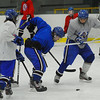 Lunenburg/Ayer Tom Wagner (center) battles for possession of the puck during practice on Tuesday.<br /> SENTINEL & ENTERPRISE / BRETT CRAWFORD