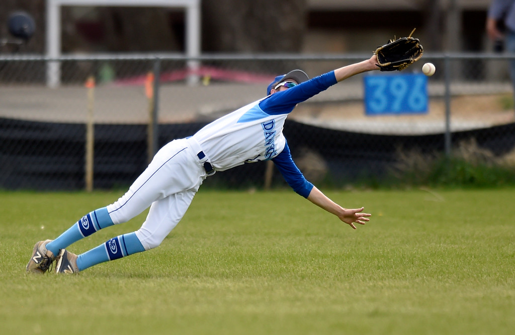 . Alexander Dawson School\'s Evan Moll narrowly misses the ball after trying to make a diving catch in the outfield during a game against Lyons on Monday in Lafayette. More photos: BoCoPreps.com Jeremy Papasso/ Staff Photographer 04/23/2018