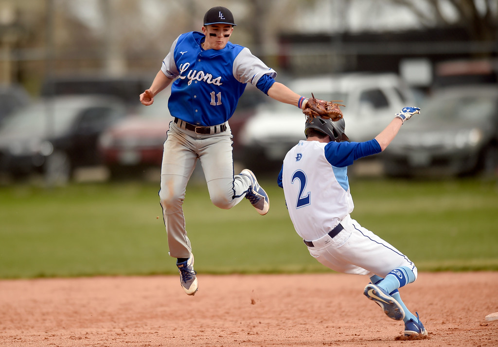 . Lyons High School\'s Evan Reeves barely misses the tag on Brandon Day at second base during a game against Alexander Dawson on Monday in Lafayette. More photos: BoCoPreps.com Jeremy Papasso/ Staff Photographer 04/23/2018