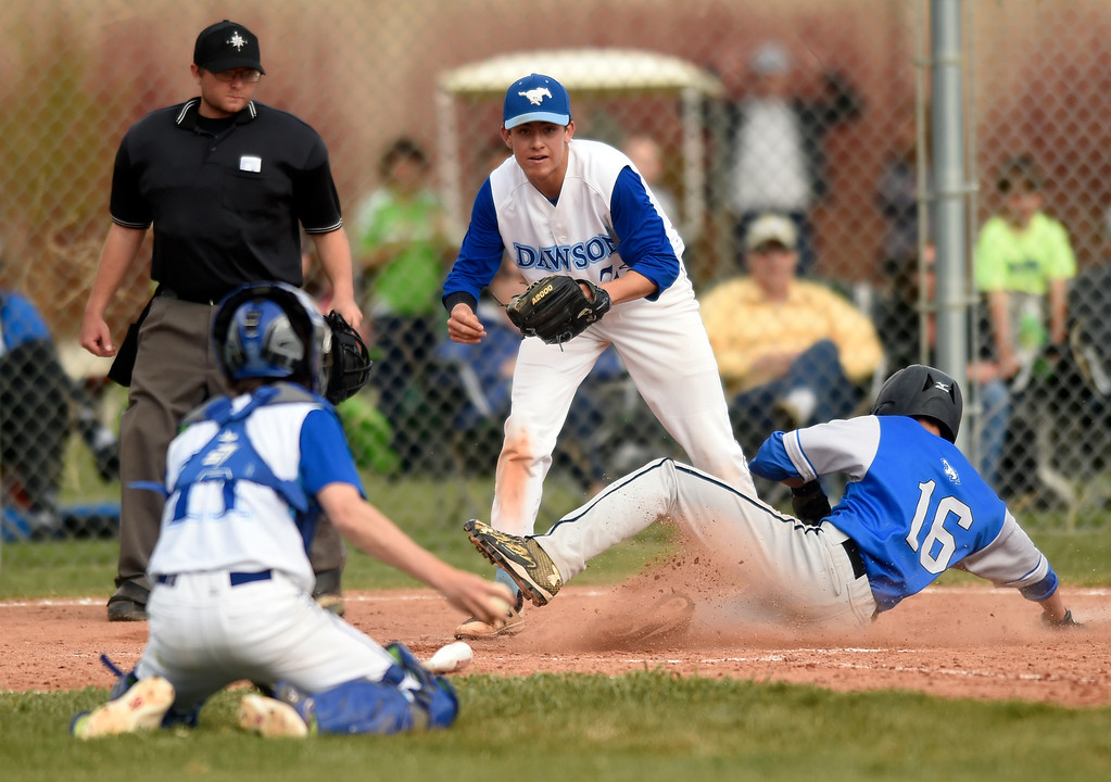 . Lyons High School\'s Sean Steuclinck slides into home plate safely during a game against Alexander Dawson on Monday in Lafayette. More photos: BoCoPreps.com Jeremy Papasso/ Staff Photographer 04/23/2018