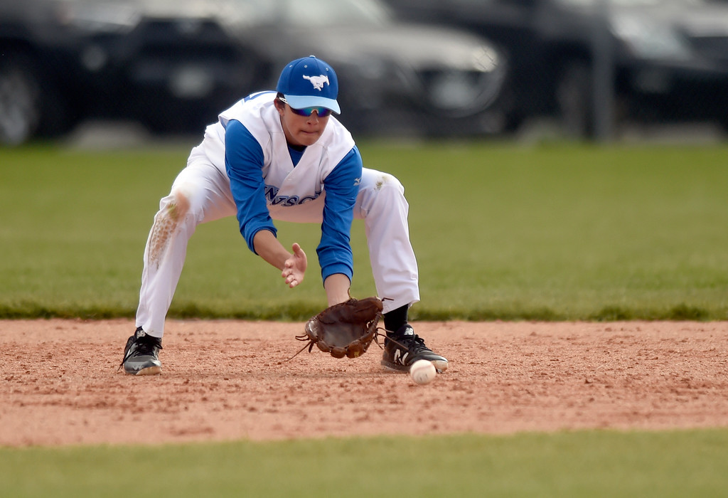 . Alexander Dawson School\'s Eli Merritt makes a stop at short-stop for an out at first base during a game against Lyons on Monday in Lafayette. More photos: BoCoPreps.com Jeremy Papasso/ Staff Photographer 04/23/2018