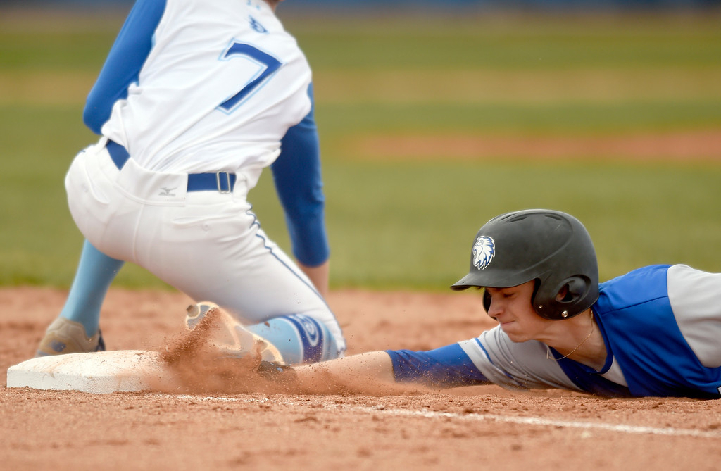 . Lyons High School\'s Brandon Sanders slides back to first base safely during a game against Alexander Dawson on Monday in Lafayette. More photos: BoCoPreps.com Jeremy Papasso/ Staff Photographer 04/23/2018