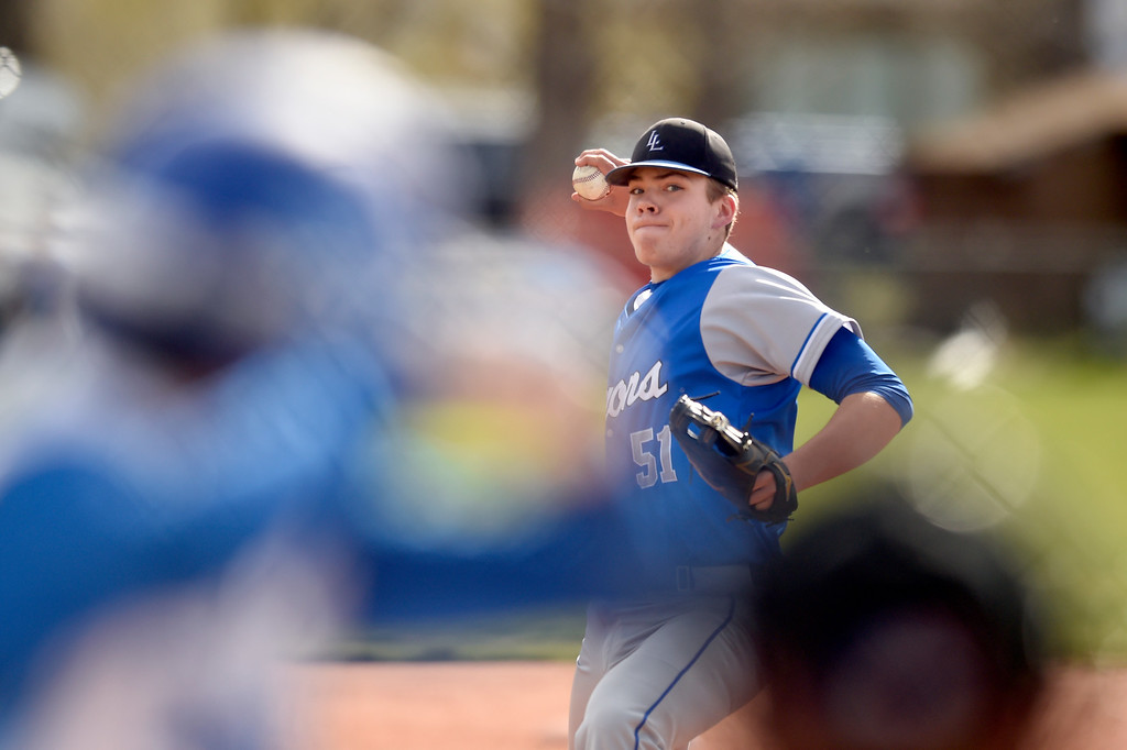 . Lyons High School pitcher Austin Clark throws a pitch  during a game against Alexander Dawson on Monday in Lafayette. More photos: BoCoPreps.com Jeremy Papasso/ Staff Photographer 04/23/2018