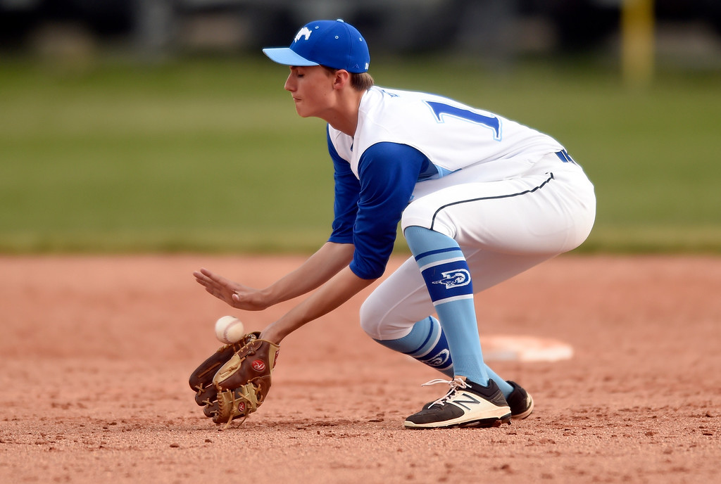 . Alexander Dawson School\'s Donovan Muniz makes a stop at second base for an out at first base during a game against Lyons on Monday in Lafayette. More photos: BoCoPreps.com Jeremy Papasso/ Staff Photographer 04/23/2018