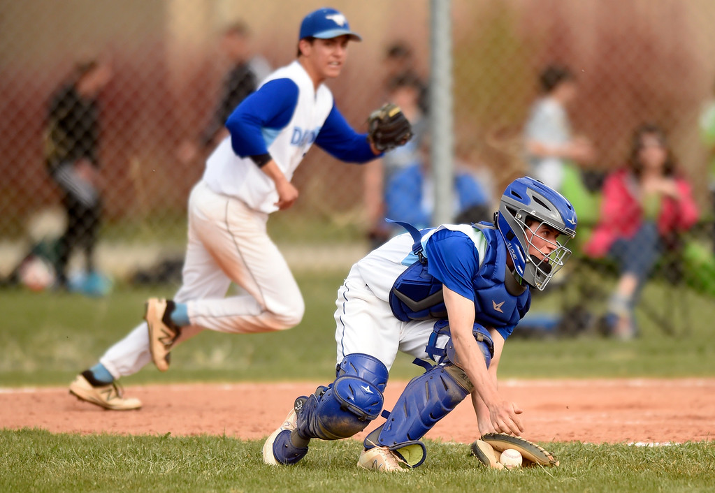 . Alexander Dawson catcher Simon Dodge grabs a loose ball for a close play at home plate during a game against Lyons on Monday in Lafayette. More photos: BoCoPreps.com Jeremy Papasso/ Staff Photographer 04/23/2018