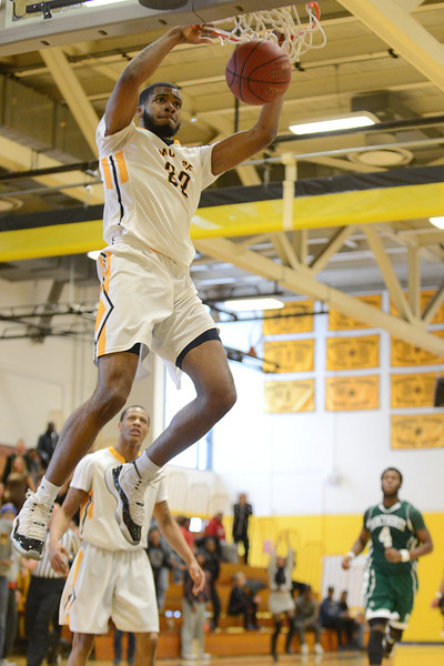 Artice Jackson from Owings Mills, MD jams home what proved to be the winning bucket as the MCC mens basketball team defeats Mercyhurst 77-75 to advance to the finals of the region III tournament.
