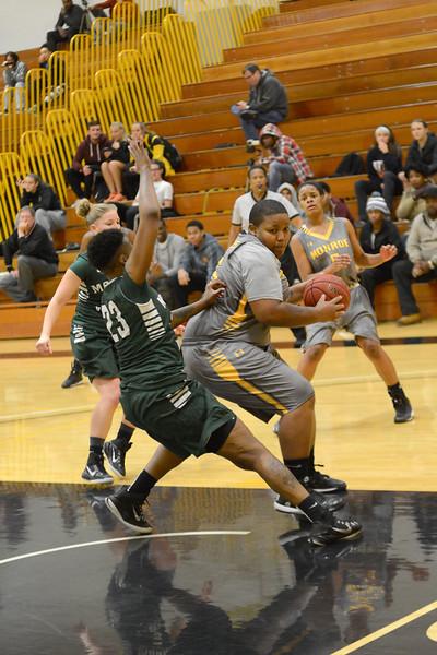 Fannisha Price clears some space in the lane against Mohawk Valley.