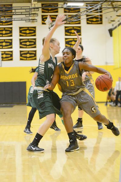 Kiki Bynes drives for the basket against Mohawk Valley