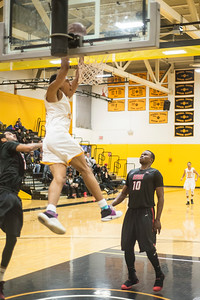 Kewan Platt dunks against Erie Community College on 28 Jan 2017