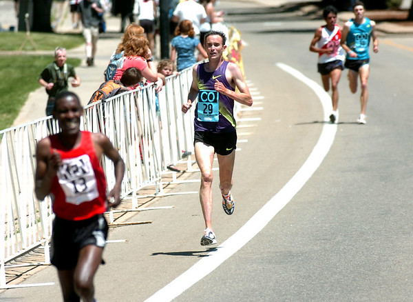 Brent Vaughn, #29, of Boulder chases John Korir #13 of Kenya during  the Men's Elite Race of the Bolder Boulder on Monday May 31, 2010<br /> Photo by Paul Aiken / The Camera / May 31, 2010