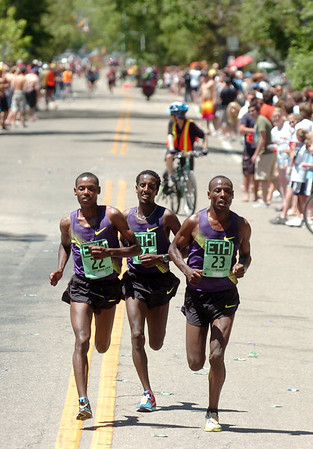 From left to right Lelisa Desisa #22, Tilahun Regassa #24, and Tadese Tola #23, of Ethiopia during the Men's Elite Race of the Bolder Boulder on Monday May 31, 2010<br /> Photo by Paul Aiken / The Camera / May 31, 2010