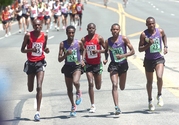 From left to right Simon Cheprot, #15, of Kenya, Tilahun Regassa #24, of Ethiopia, Philemon Terer Kiplangat, #14, Kenya,  Lelisa Desisa #22, and Tadese Tola #23 both of Ethiopia run during the Men's Elite Race of the Bolder Boulder on Monday May 31, 2010<br /> Photo by Paul Aiken / The Camera / May 31, 2010