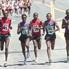 From left to right Simon Cheprot, #15, of Kenya, Tilahun Regassa #24, of Ethiopia, Philemon Terer Kiplangat, #14, Kenya,  Lelisa Desisa #22, and Tadese Tola #23 both of Ethiopia run during the Men's Elite Race of the Bolder Boulder on Monday May 31, 2010<br /> Photo by Paul Aiken / The Camera / May 31, 2010