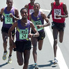 From left to right Tadese Tola #23, Tilahun Regassa #24, and Lelisa Desisa #22, of Ethiopia are chased by Philemon Terer Kiplangat, #14,  Simon Cheprot, #15, of Kenya during the Men's Elite Race of the Bolder Boulder on Monday May 31, 2010<br /> Photo by Paul Aiken / The Camera / May 31, 2010