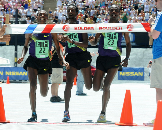 BOLDER<br /> Left to right, Ethiopian runners Lelisa Desisa, Tilahun Regassa, and Tadese Tola celebrate their group win during the 32nd Annual Day Bolder Boulder on Monday. <br /> Photo by Marty Caivano/Camera/May 31, 2010