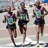 From left to right Tadese Tola #23, Tilahun Regassa #24, and Lelisa Desisa #22, of Ethiopia during the Men's Elite Race of the Bolder Boulder on Monday May 31, 2010<br /> Photo by Paul Aiken / The Camera / May 31, 2010
