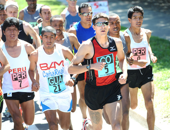 Patrick Rizzo Team Colorado runs in the pack of the International Team Challenge Pro Men's  Race during the 2012 Bolder Boulder.<br /> Photo by Paul Aiken / The Camera<br /> Photo by Paul Aiken / The Camera