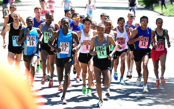 Lani Rutto, 17, of Kenya at left, dues with Demessew Tsega, 24, of Ethiopia early in the International Team Challenge Pro Men's  Race during the 2012 Bolder Boulder.<br /> Photo by Paul Aiken / The Camera<br /> Photo by Paul Aiken / The Camera