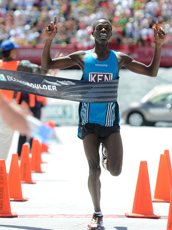 "Kenya's Allan Kiprono breaks through the finish line of the Bolder Boulder's Elite Men's 10K race on Monday, May 28. For more photos of the race go to  <a href=""http://www.dailycamera.com"">http://www.dailycamera.com</a><br /> Jeremy Papasso/ Camera"