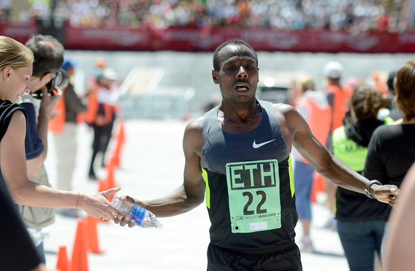 """Ethiopia's Tadese Tola crosses the finish line in second place at the Bolder Boulder Elite Men's 10K race on Monday, May 28. For more photos of the race go to  <a href=""""http://www.dailycamera.com"""">http://www.dailycamera.com</a><br /> Jeremy Papasso/ Camera"""