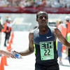 "Ethiopia's Tadese Tola crosses the finish line in second place at the Bolder Boulder Elite Men's 10K race on Monday, May 28. For more photos of the race go to  <a href=""http://www.dailycamera.com"">http://www.dailycamera.com</a><br /> Jeremy Papasso/ Camera"
