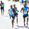 Allan Kiprono  and teammate Lani Rutto lead Brihanu Gedefa of Ethiopia during the International Team Challenge Pro Men's  Race during the 2012 Bolder Boulder.<br /> Photo by Paul Aiken / The Camera<br /> Photo by Paul Aiken / The Camera