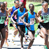 From left to right Tadese Tola, Lani Rutto, Allan Kiprono, and Demessew Tsega  run in a bunch during International Team Challenge Pro Men's  Race during the 2012 Bolder Boulder. Kiprono of Kenya was the race winner.<br /> Photo by Paul Aiken / The Camera
