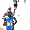 Allan Kiprono of Kenya pulls away from his competition to Win the International Team Challenge Pro Men's  Race during the 2012 Bolder Boulder.<br /> Photo by Paul Aiken / The Camera<br /> Photo by Paul Aiken / The Camera
