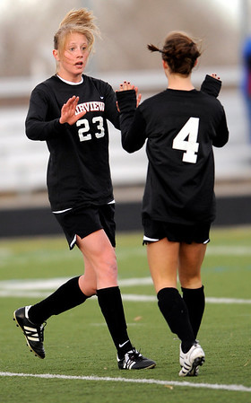 Fairview's Annie Stuller (L) gets a high five from Olivia Fear (R) after Stuller scored her first goal against Monarch during their game at Monarch High School in Louisville, Colorado April 6, 2010.  CAMERA/Mark Leffingwell