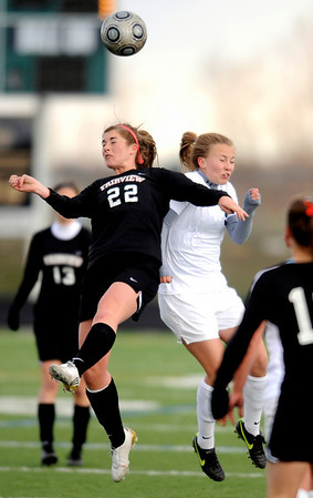 Fairview's Keelyn Arnold (L) and Monarch's Haley Schumacher (R) collide going for the ball during their game at Monarch High School in Louisville, Colorado April 6, 2010.  CAMERA/Mark Leffingwell