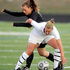 Monarch's Carly Bolyard (R) battles Fairview's Daphanee Morency (L)for the ball during their game at Monarch High School in Louisville, Colorado April 6, 2010.  CAMERA/Mark Leffingwell