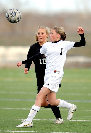 Monarch's Brenna Stimac (R) cuts Fairview's Paige Banks off from the ball during their game at Monarch High School in Louisville, Colorado April 6, 2010.  CAMERA/Mark Leffingwell