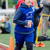 Lunenburg's Brandon Nauman gives a thumbs up while running the 800 meter during the First Annual MIAA Special Olympics Massachusetts Unified Track State Championship at Fitchburg State University on Tuesday afternoon. SENTINEL & ENTERPRISE / Ashley Green