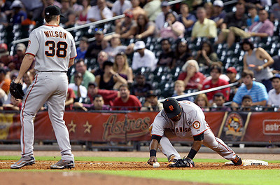 June 22, 2010 - Giants closer Brian Wilson watches as first baseman Pablo Sandoval holds on to record the final out of the game, giving the Giants a 3-1 win and Wilson his 20th save of the season.