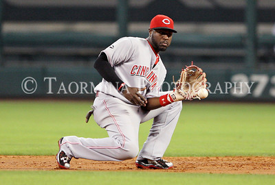 May 10, 2011; Houston, TX, USA;  Cincinnati Reds infielder Brandon Phillips (4) fields a ground ball in the first inning against the Houston Astros at Minute Maid Park. Mandatory Credit: Troy Taormina-US PRESSWIRE