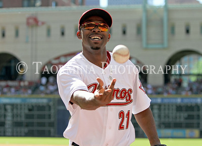 May 14, 2011; Houston, TX, USA;  Houston Astros outfielder Michael Bourn (21) tosses a baseball to a fan in the middle of the fifth inning against the New York Mets at Minute Maid Park. Mandatory Credit: Troy Taormina-US PRESSWIRE