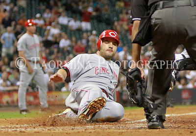 August 03, 2011; Houston, TX, USA; Cincinnati Reds infielder Joey Votto (19) slides safely into home plate to score a run against the Houston Astros at Minute Maid Park. Mandatory Credit: Troy Taormina-US PRESSWIRE