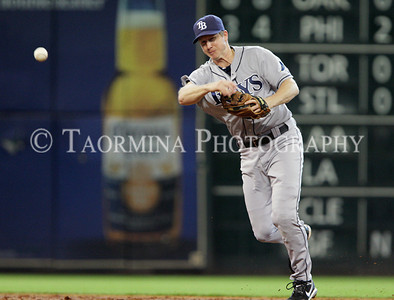 June 26, 2011; Houston, TX, USA; Tampa Bay Rays infielder Elliot Johnson (9) throws to first base in the third inning against the Houston Astros at Minute Maid Park. Mandatory Credit: Troy Taormina-US PRESSWIRE