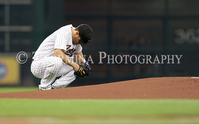 June 13, 2011; Houston, TX, USA; Houston Astros pitcher Wandy Rodriguez (51) prepares to pitch before the first inning against the Atlanta Braves at Minute Maid Park. Mandatory Credit: Troy Taormina-US PRESSWIRE