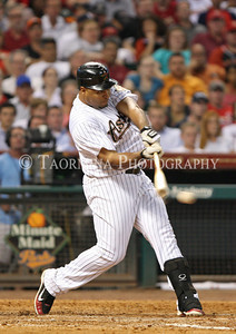 April 26, 2011; Houston, TX, USA; Houston Astros outfielder Carlos Lee (45) singles against the St. Louis Cardinals at Minute Maid Park. Mandatory Credit: Troy Taormina-US PRESSWIRE